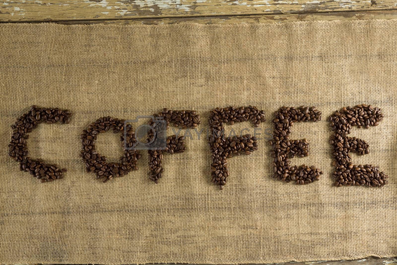 Word coffee arranged with coffee beans by Wavebreakmedia