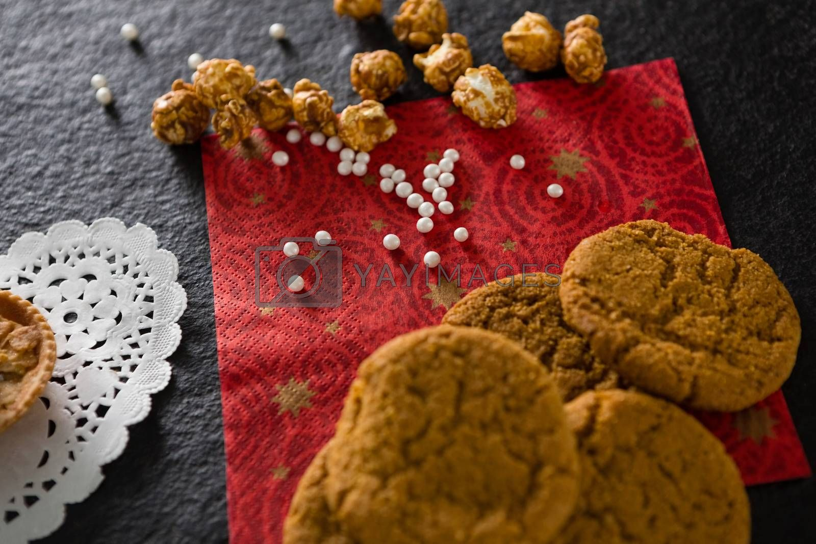 Cookies with pearls on red place mat by Wavebreakmedia