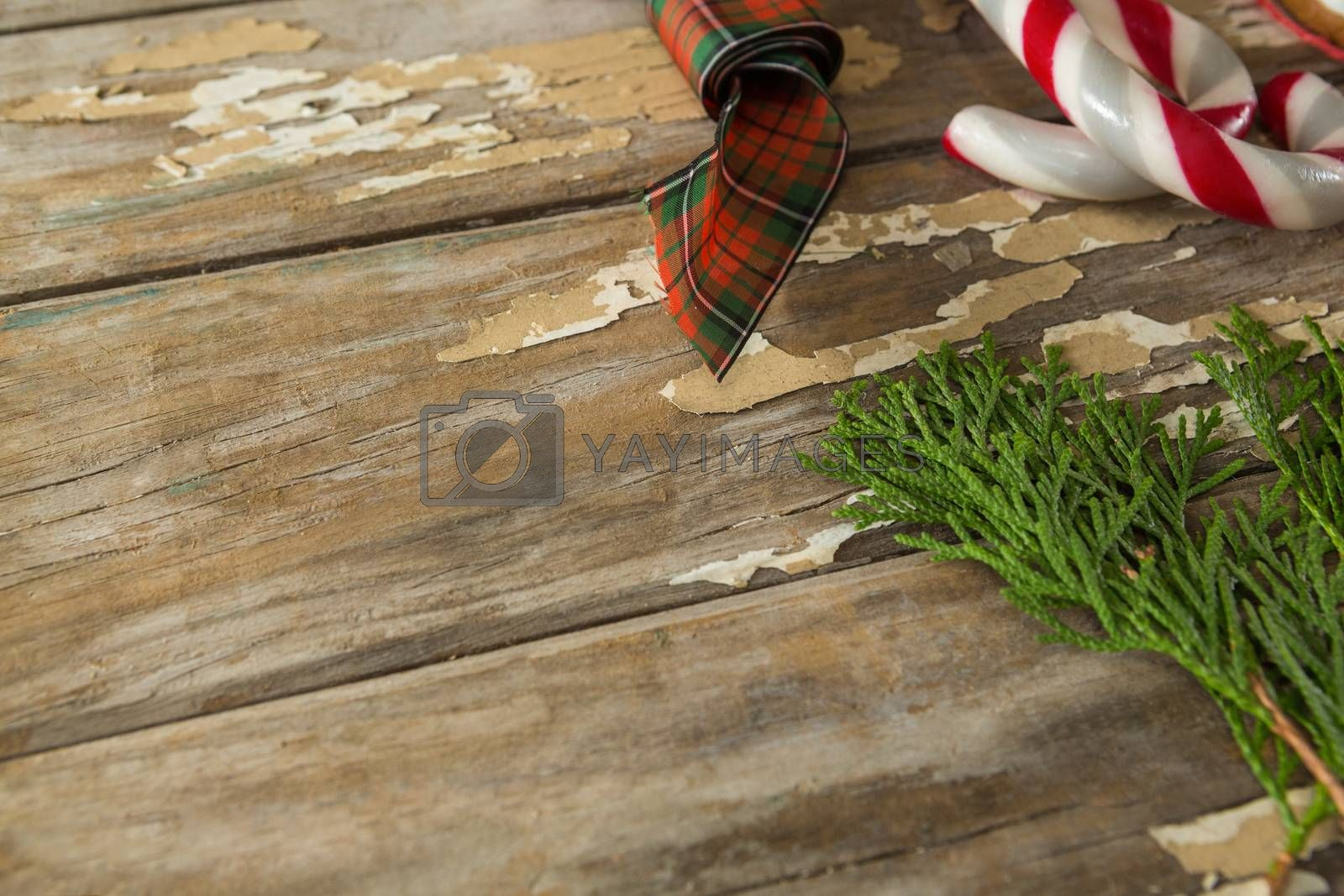 Sweet food and christmas decorations on wooden plank by Wavebreakmedia