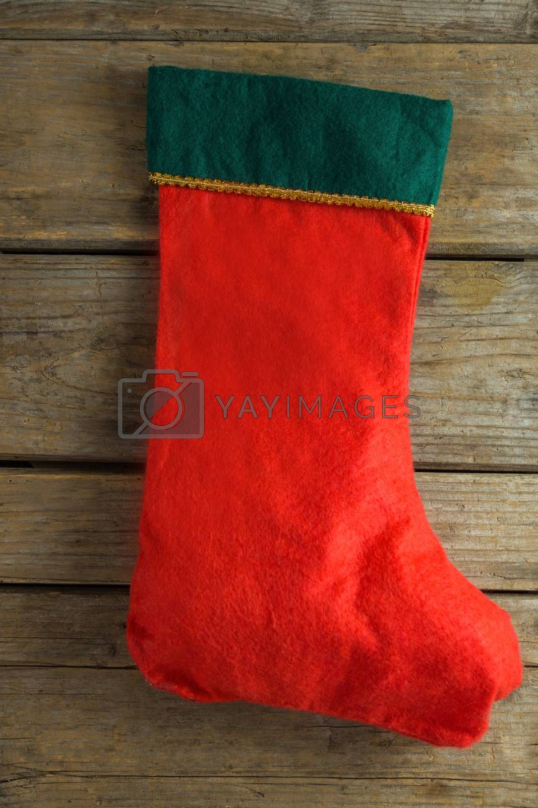 Christmas stocking on wooden plank by Wavebreakmedia