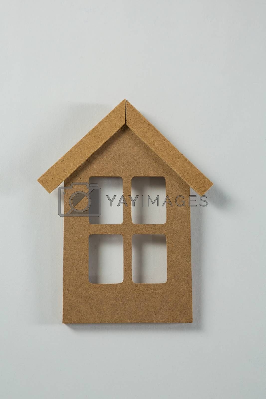 Wooden house shape decoration on table by Wavebreakmedia