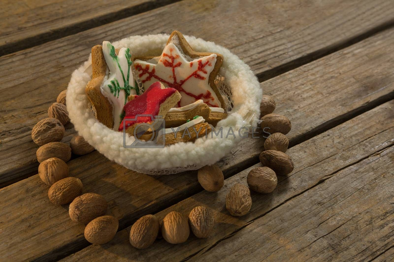 High angle view of star shape cookies in bowl amidst walnuts by Wavebreakmedia