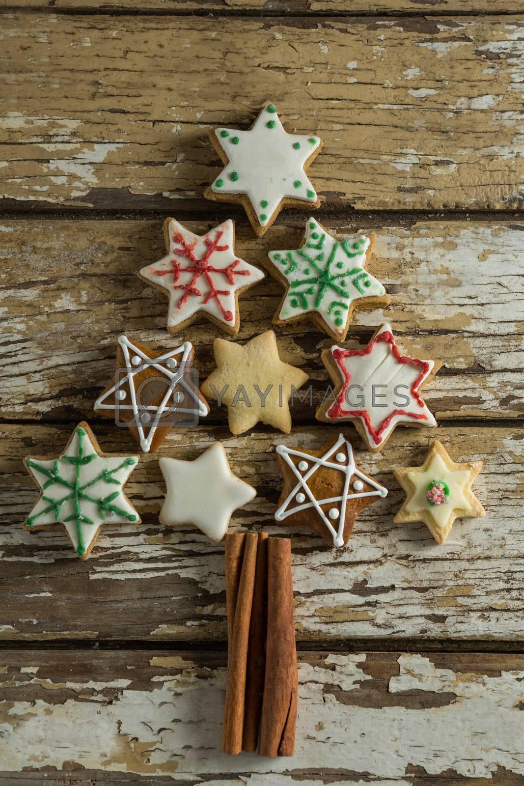 Gingerbread cookies arranged in christmas tree shape by Wavebreakmedia