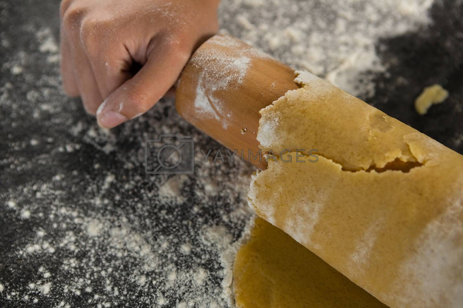 Hand baking dough with rolling pin by Wavebreakmedia