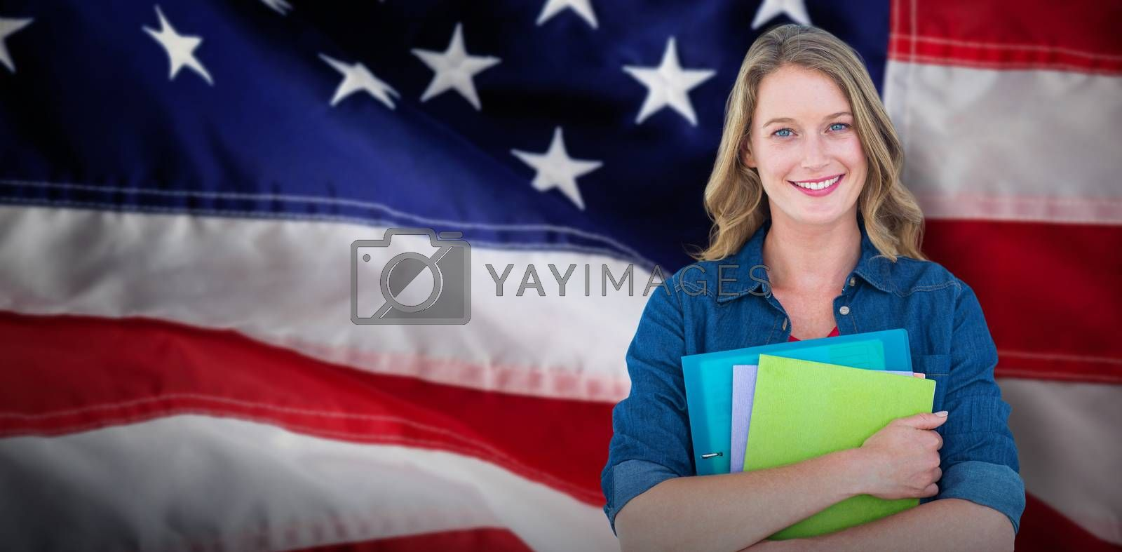 Composite image of smiling student holding notebook and file  by Wavebreakmedia