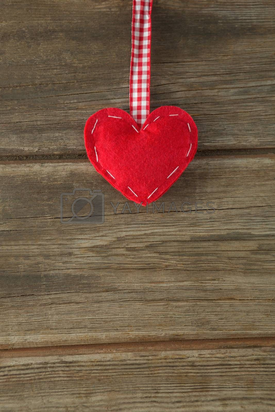 Handmade christmas decoration on wooden plank by Wavebreakmedia