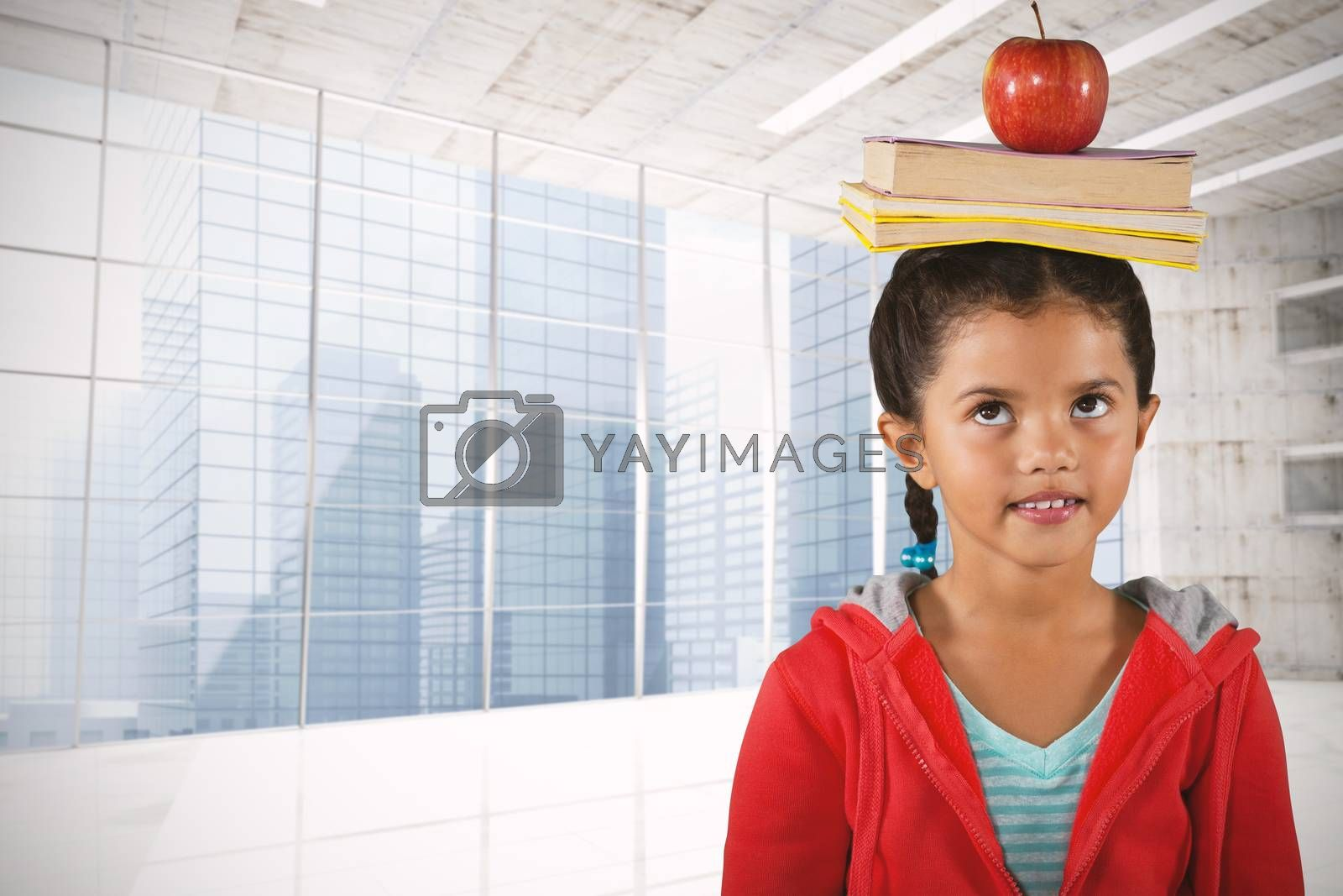Composite image of girl balancing books and apple on head by Wavebreakmedia