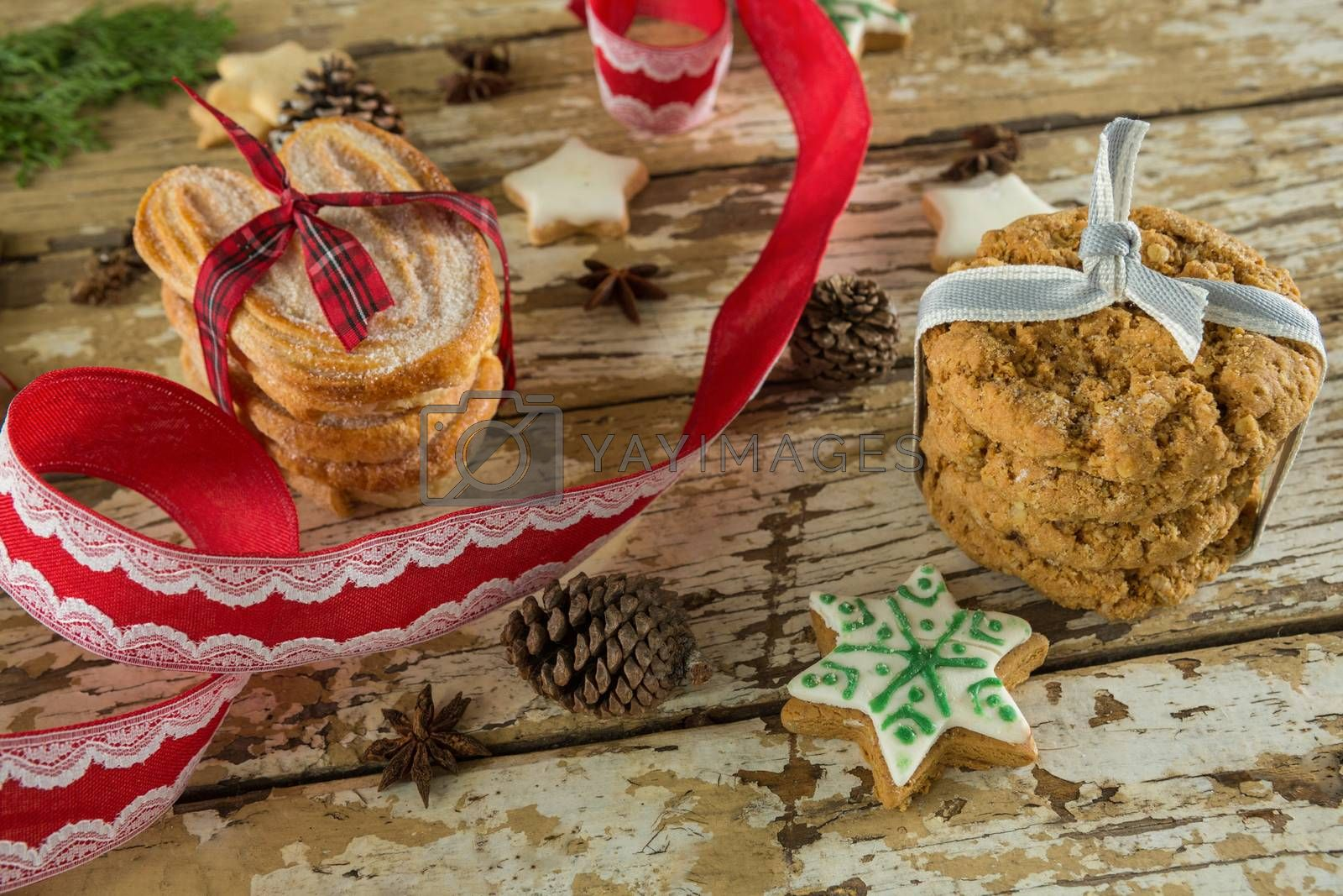 Cookies and christmas decoration on wooden plank by Wavebreakmedia