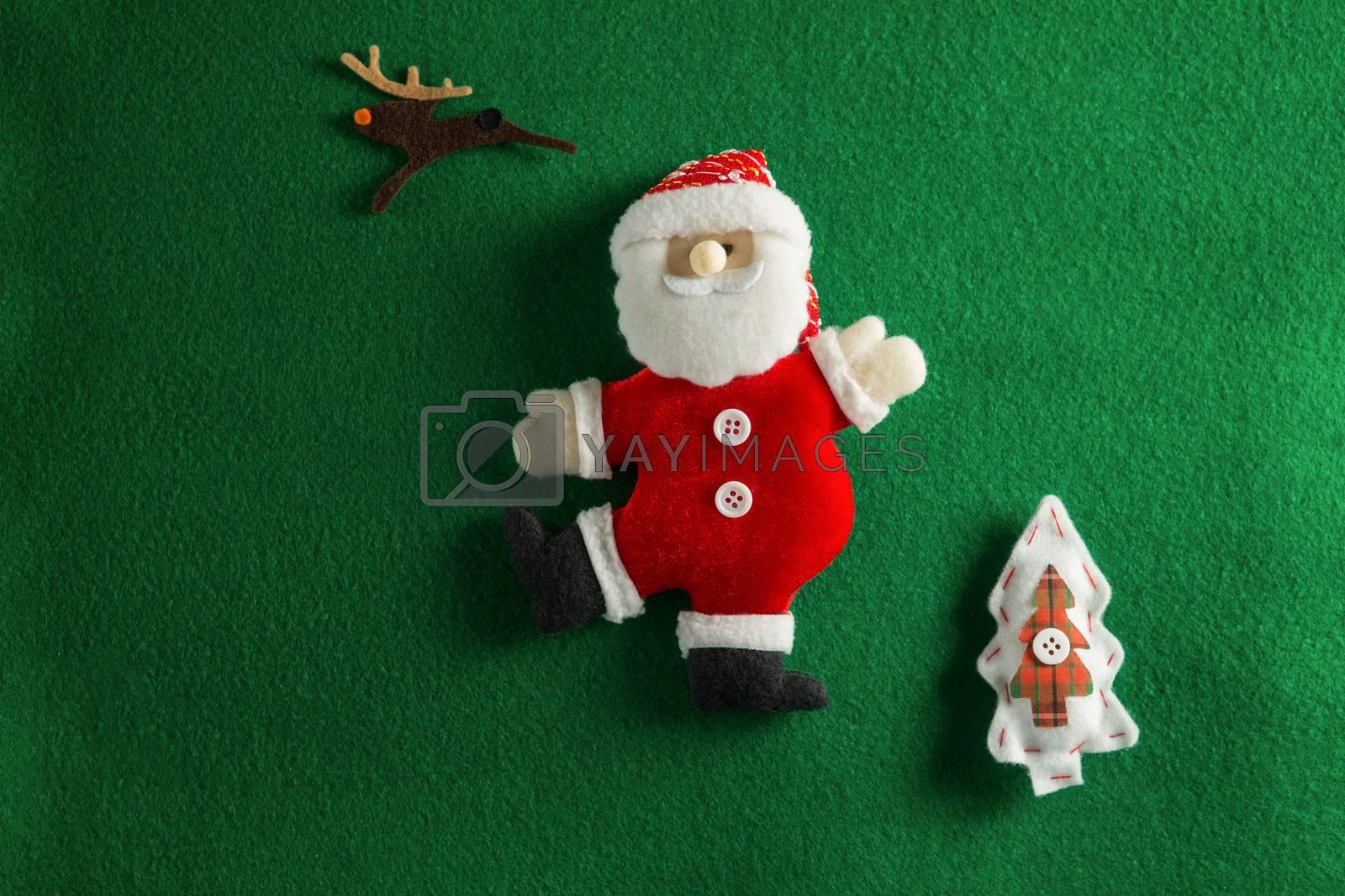 Christmas decoration on green background by Wavebreakmedia