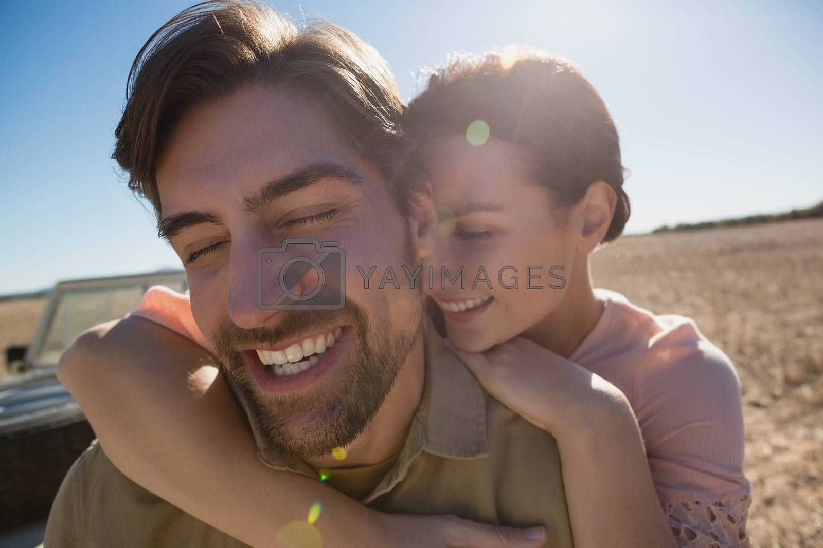 Happy couple with eyes closed on landscape by Wavebreakmedia