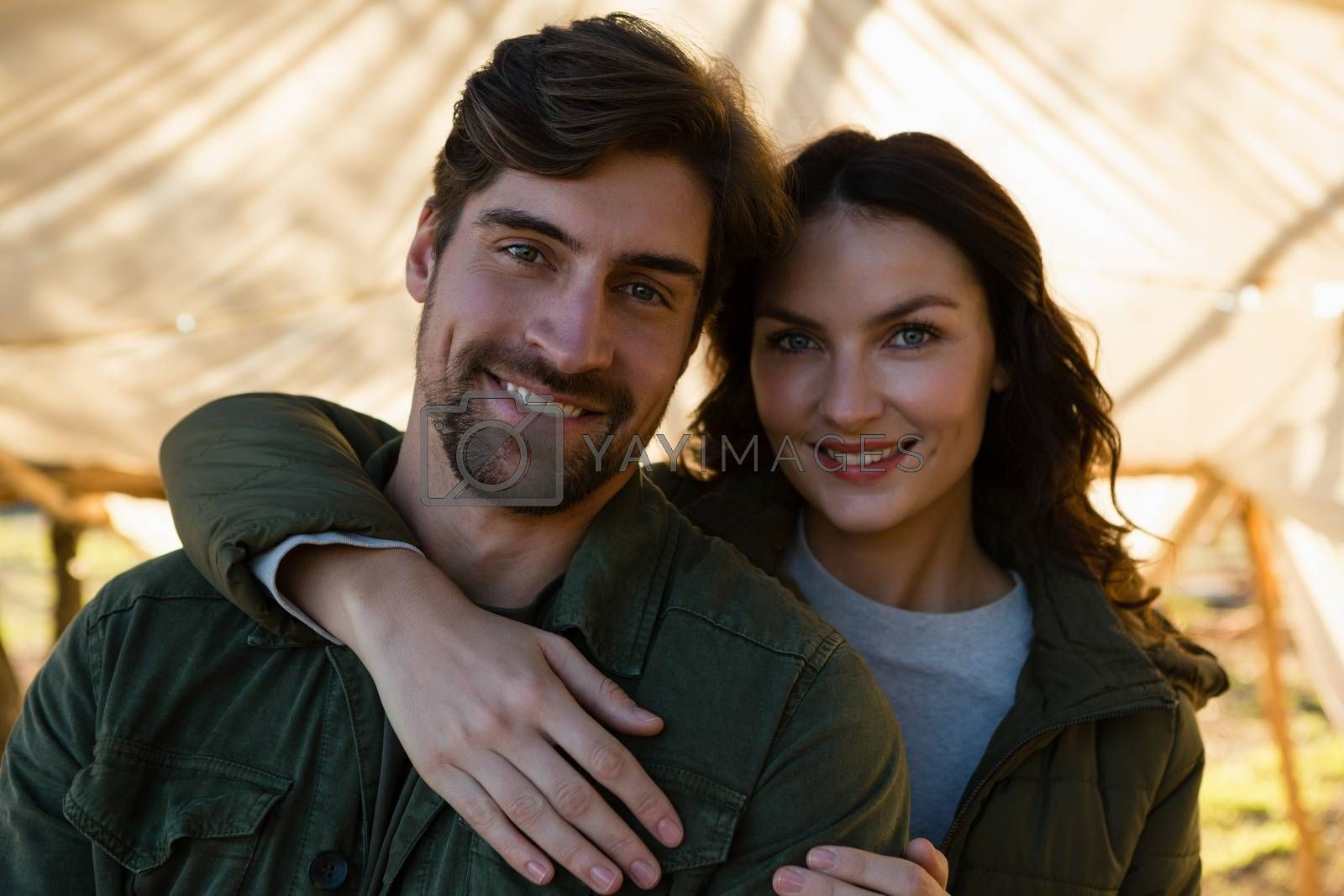 Portrait of smiling couple in tent by Wavebreakmedia
