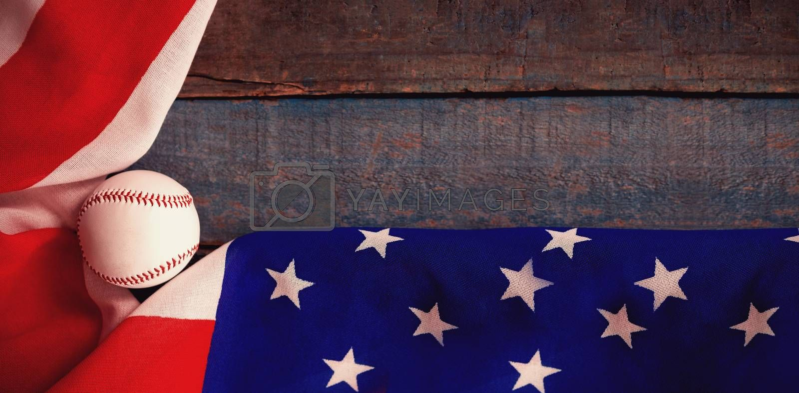 Baseball and American flag on wooden table by Wavebreakmedia