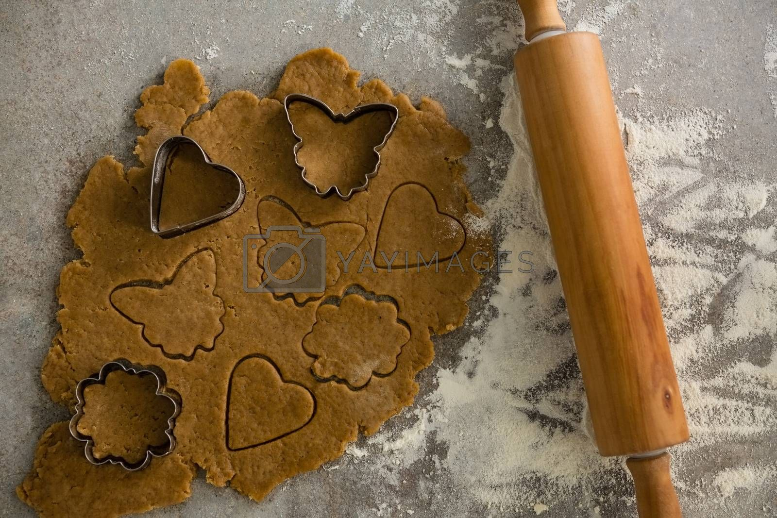 Gingerbread dough with flour, cookie cutter and rolling pin by Wavebreakmedia