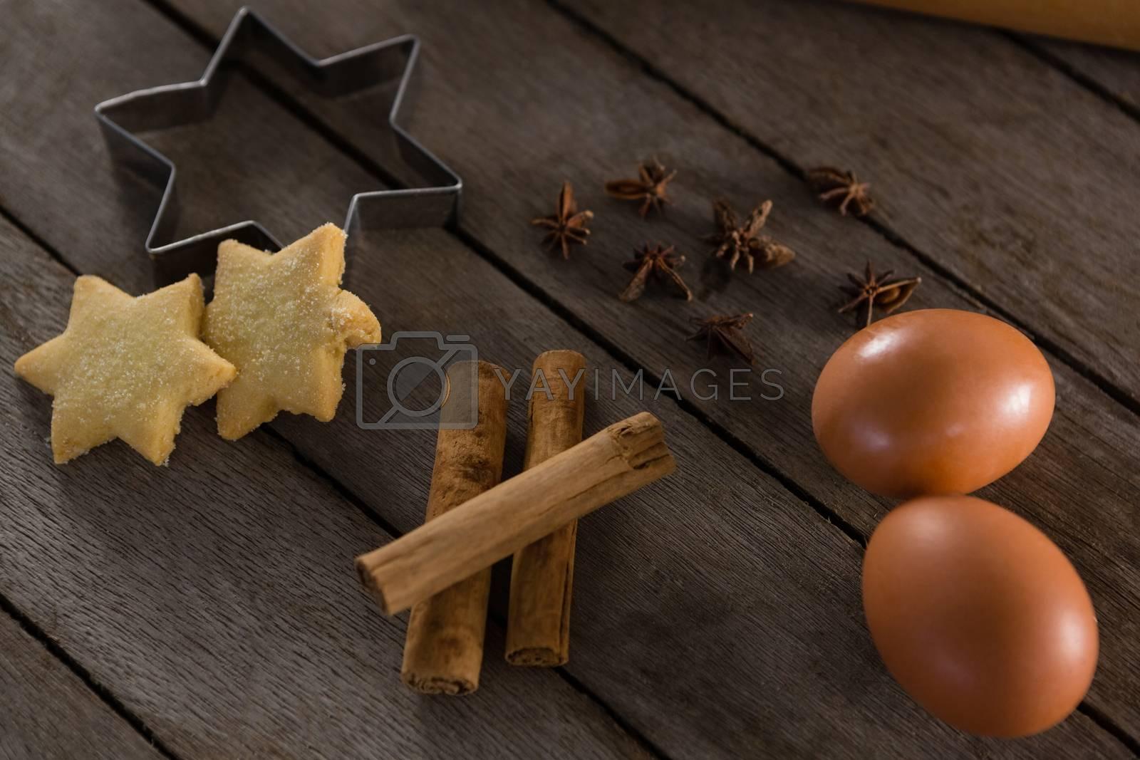 Eggs, cookie cutter, cookies, cinnamon and anise by Wavebreakmedia