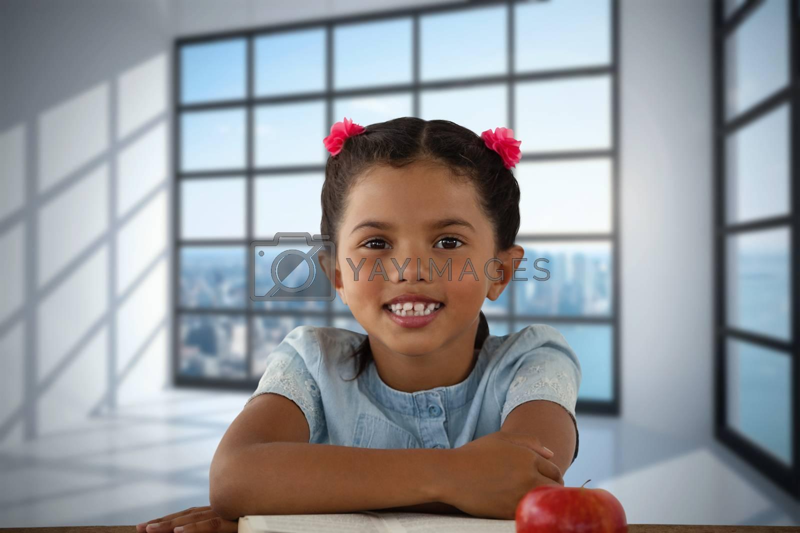 Composite image of smiling girl sitting at desk by Wavebreakmedia