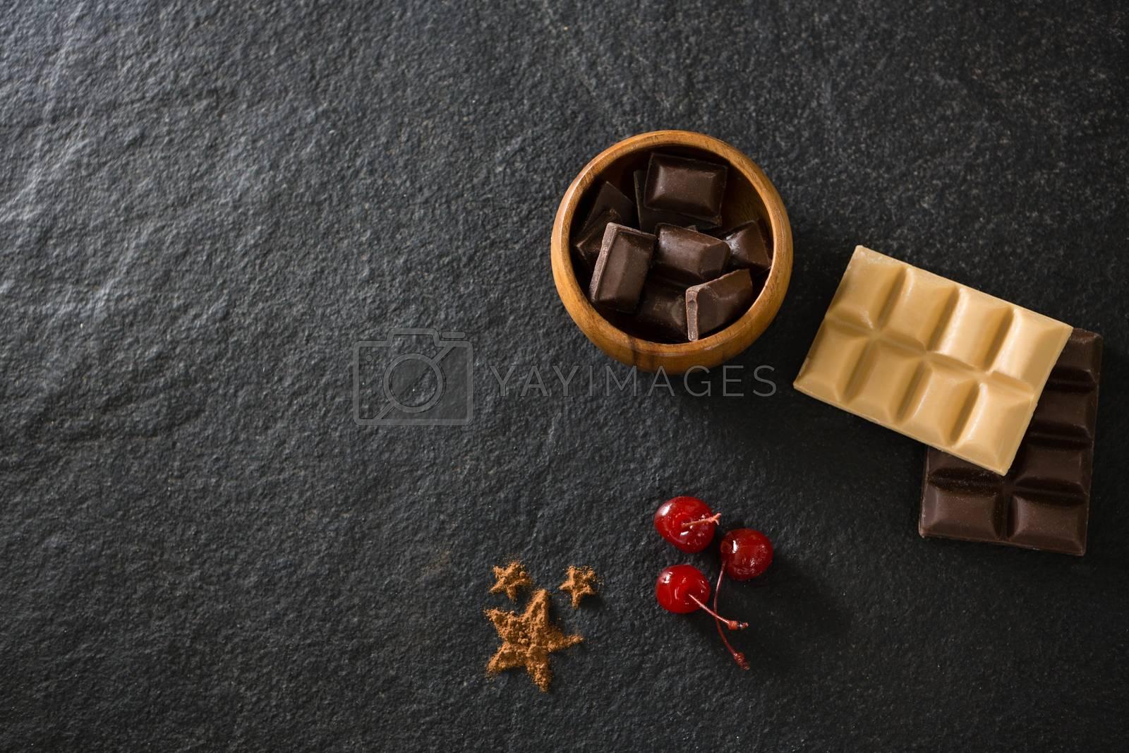 Chocolates and fruit on concrete background by Wavebreakmedia