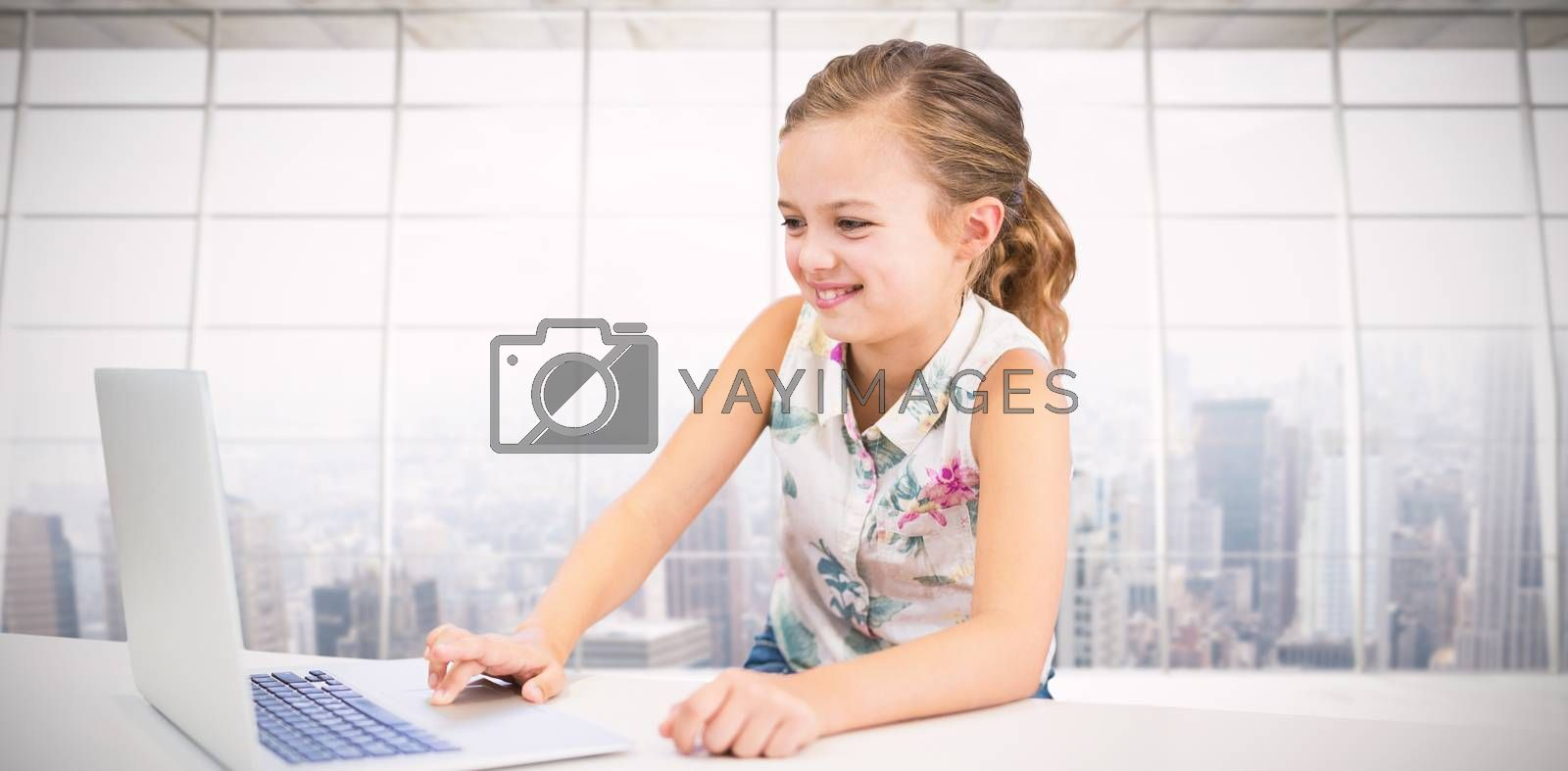Composite image of girl using laptop at table by Wavebreakmedia