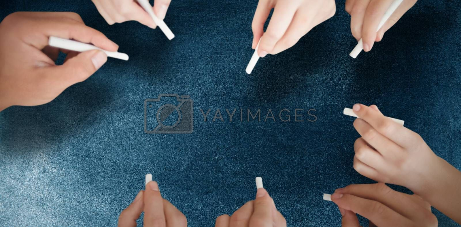 Composite image of business people writing with chalks by Wavebreakmedia