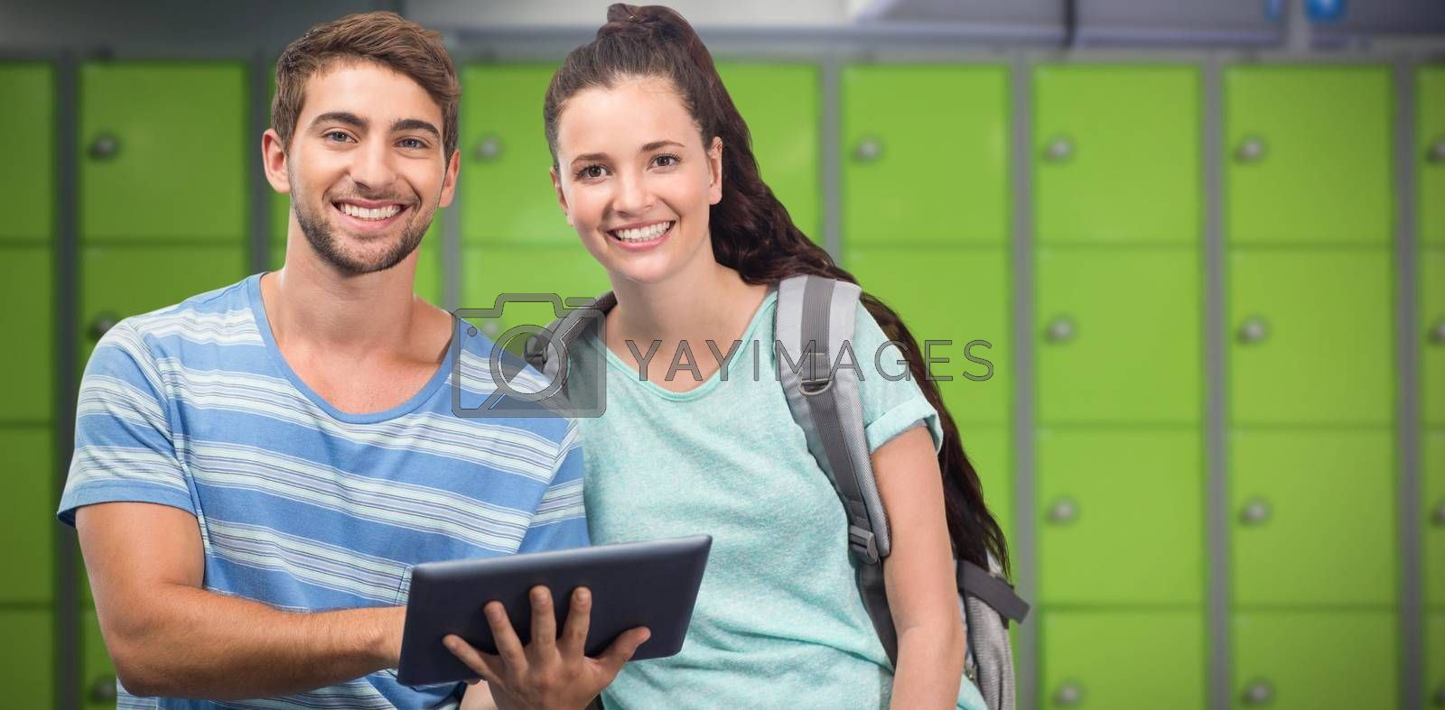 Composite image of students using tablet and smiling by Wavebreakmedia