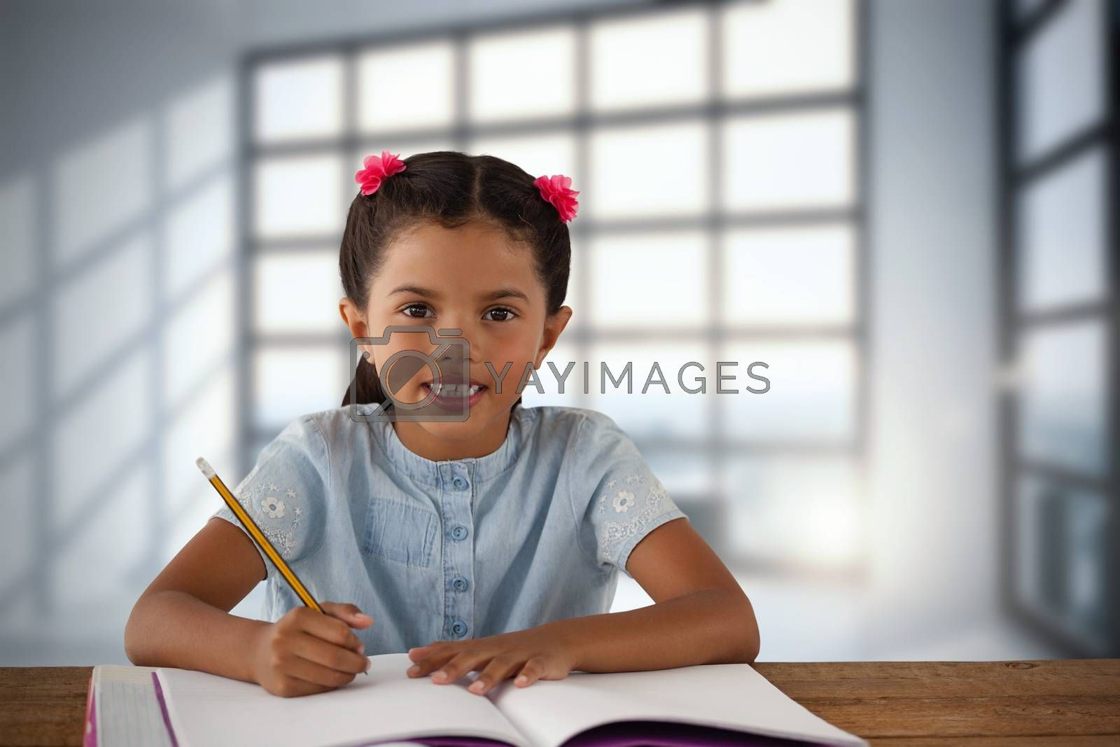 Composite image of smiling girl writing in book at desk by Wavebreakmedia