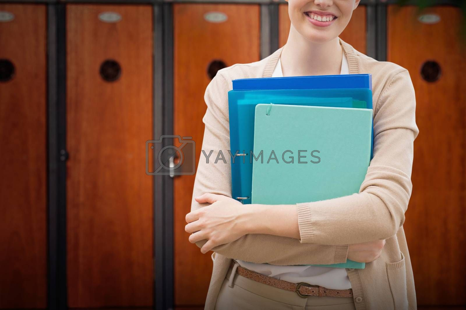 Composite image of teacher with files by Wavebreakmedia