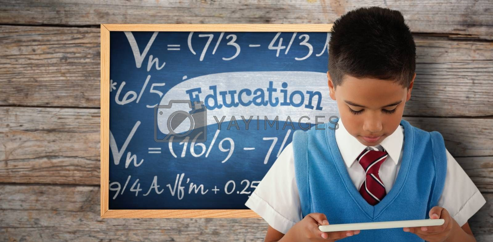 Composite image of schoolboy using digital tablet by Wavebreakmedia