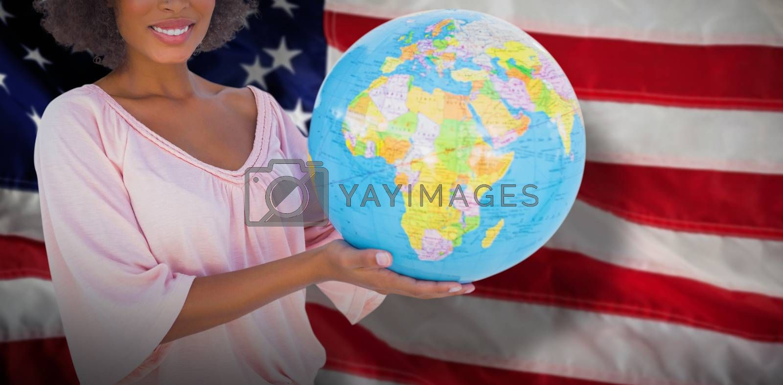 Composite image of smiling woman holding globe by Wavebreakmedia