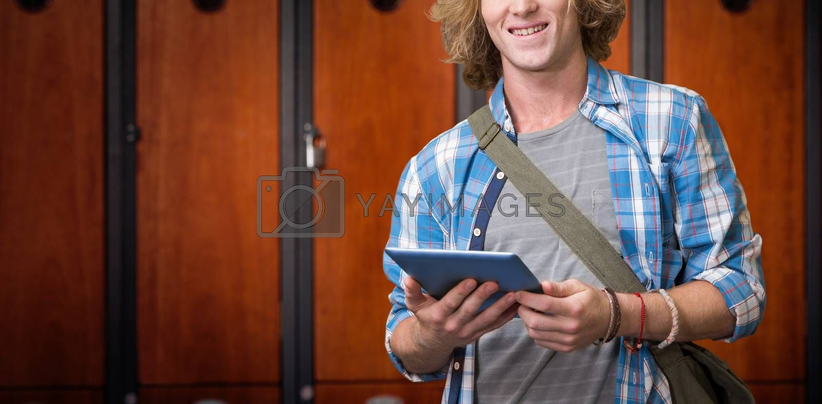 Composite image of student using tablet in library  by Wavebreakmedia