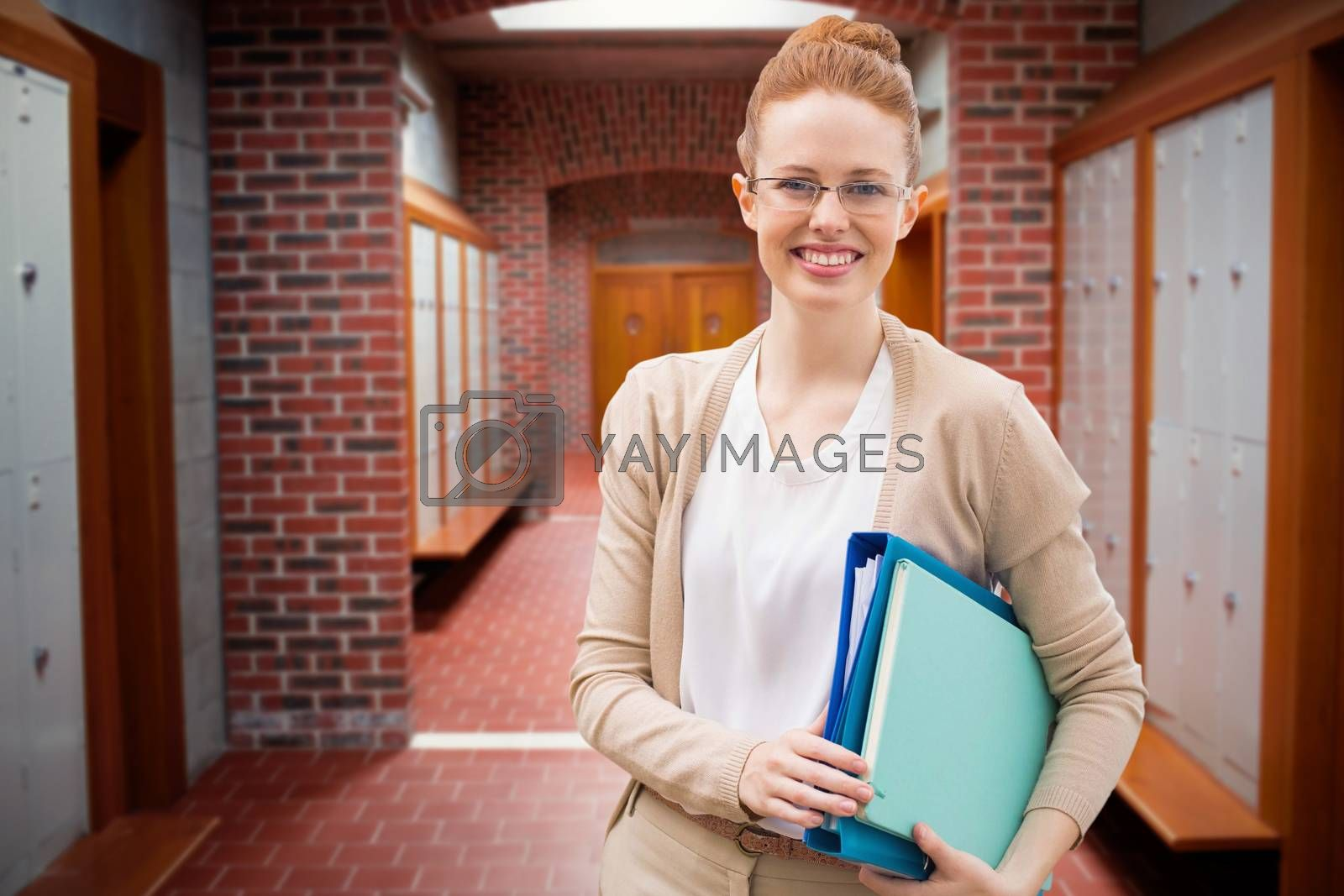 Composite image of teacher with books by Wavebreakmedia