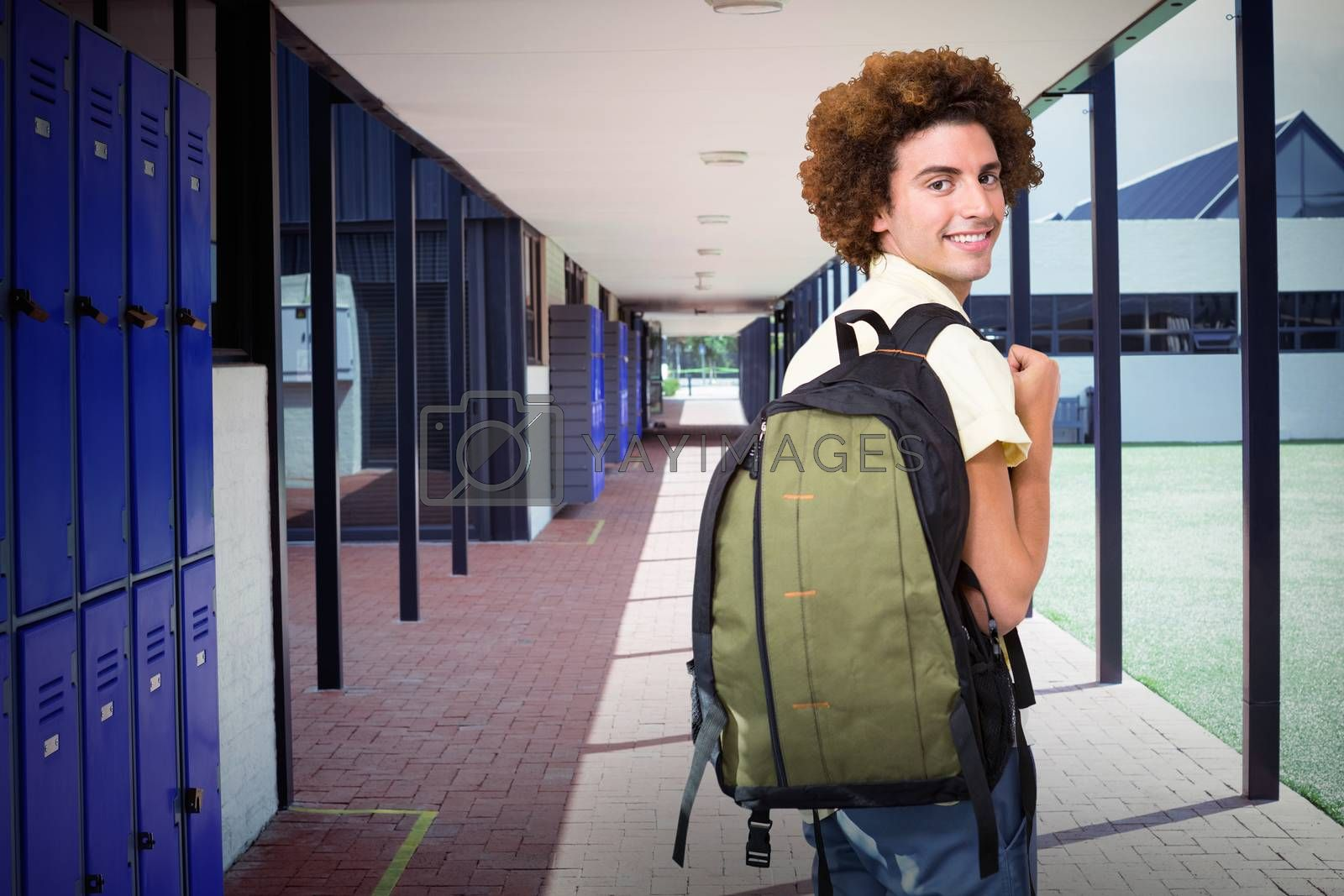 Composite image of casual young man in office corridor by Wavebreakmedia