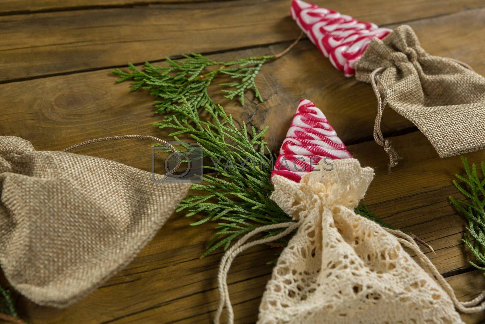 High angle view of mint candies in jute sack with twigs by Wavebreakmedia