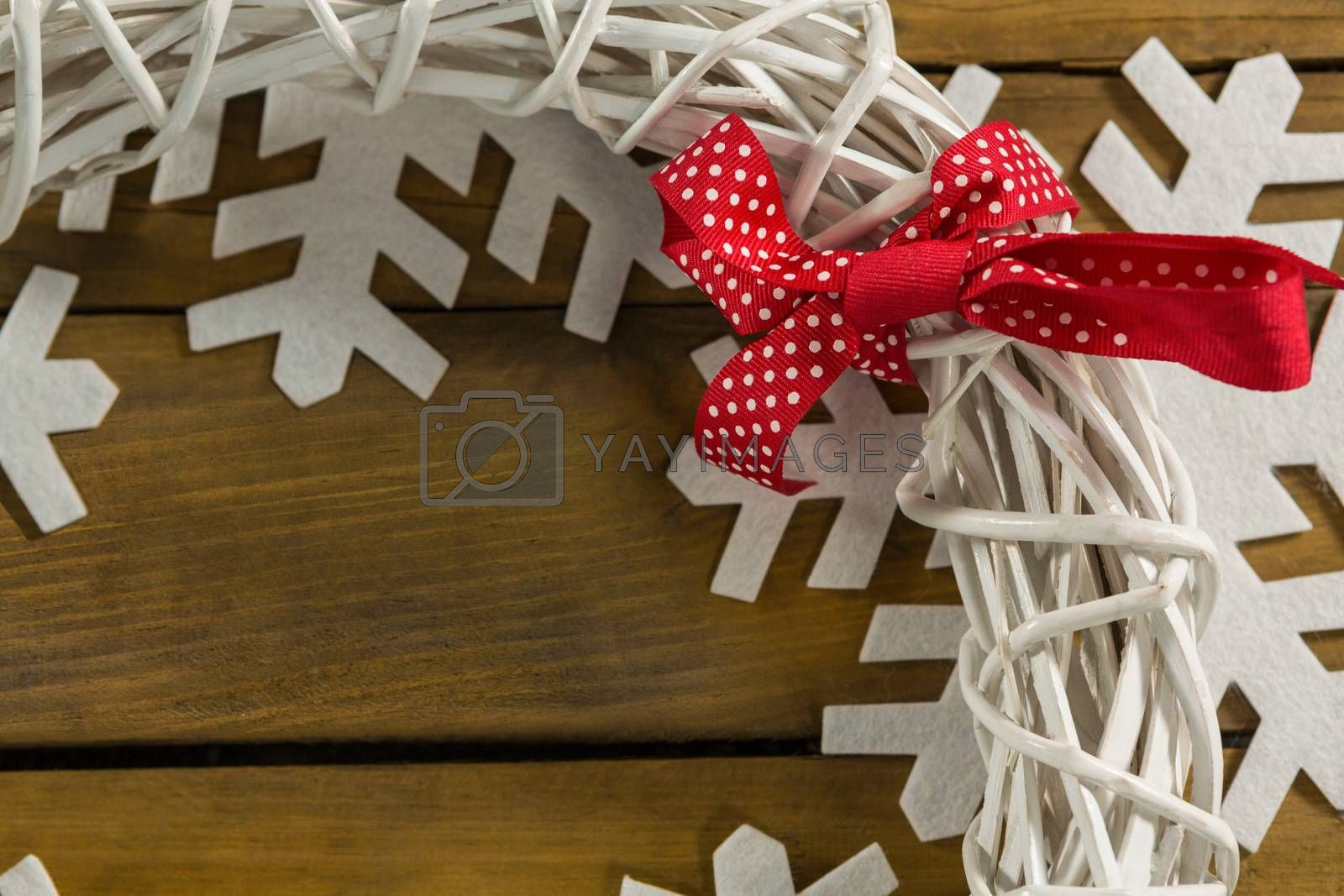 Cropped image of wreath decoration on artificial snow flake by Wavebreakmedia