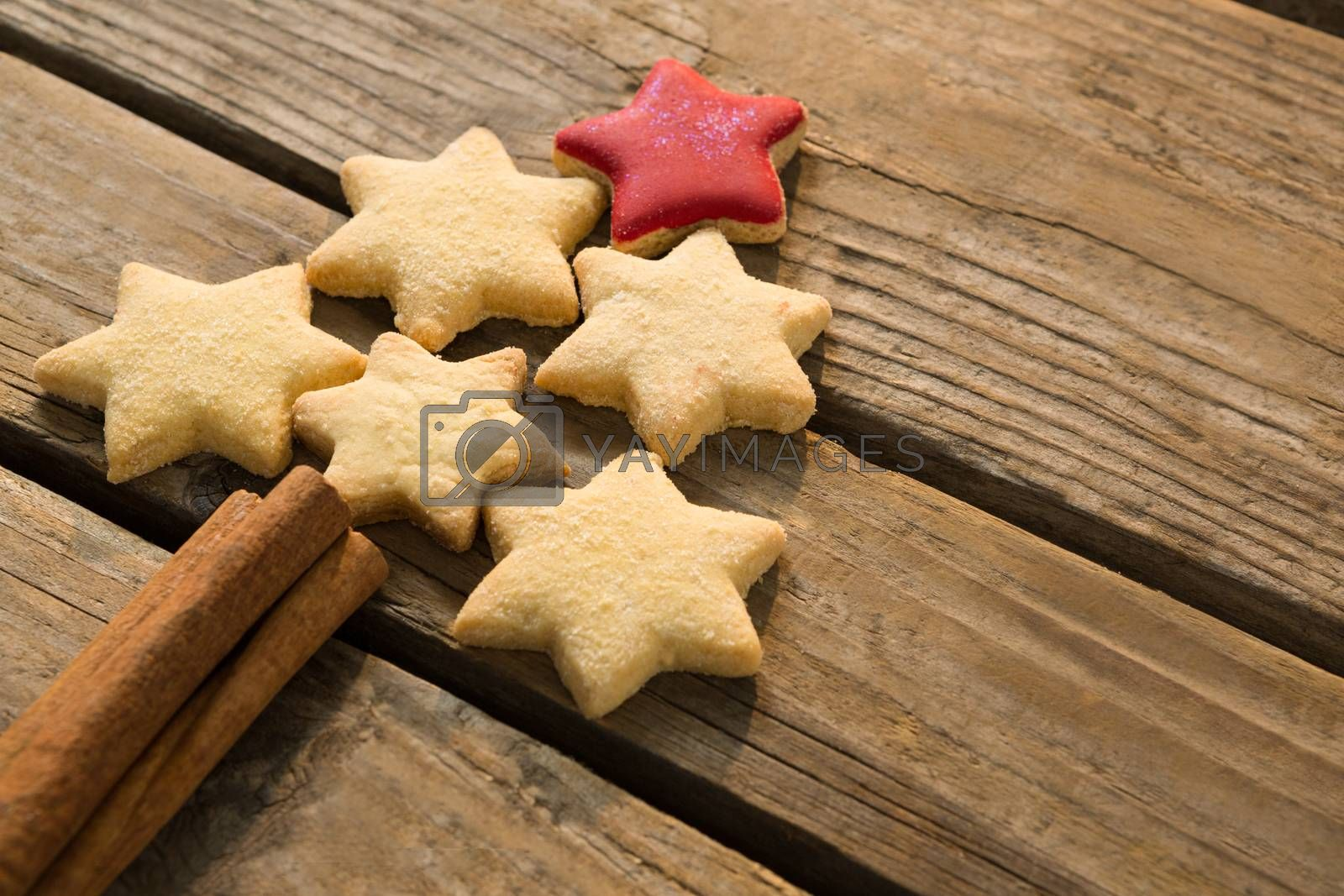 High angle view of Christmas tree made with star shape cookies and cinnamon sticks by Wavebreakmedia