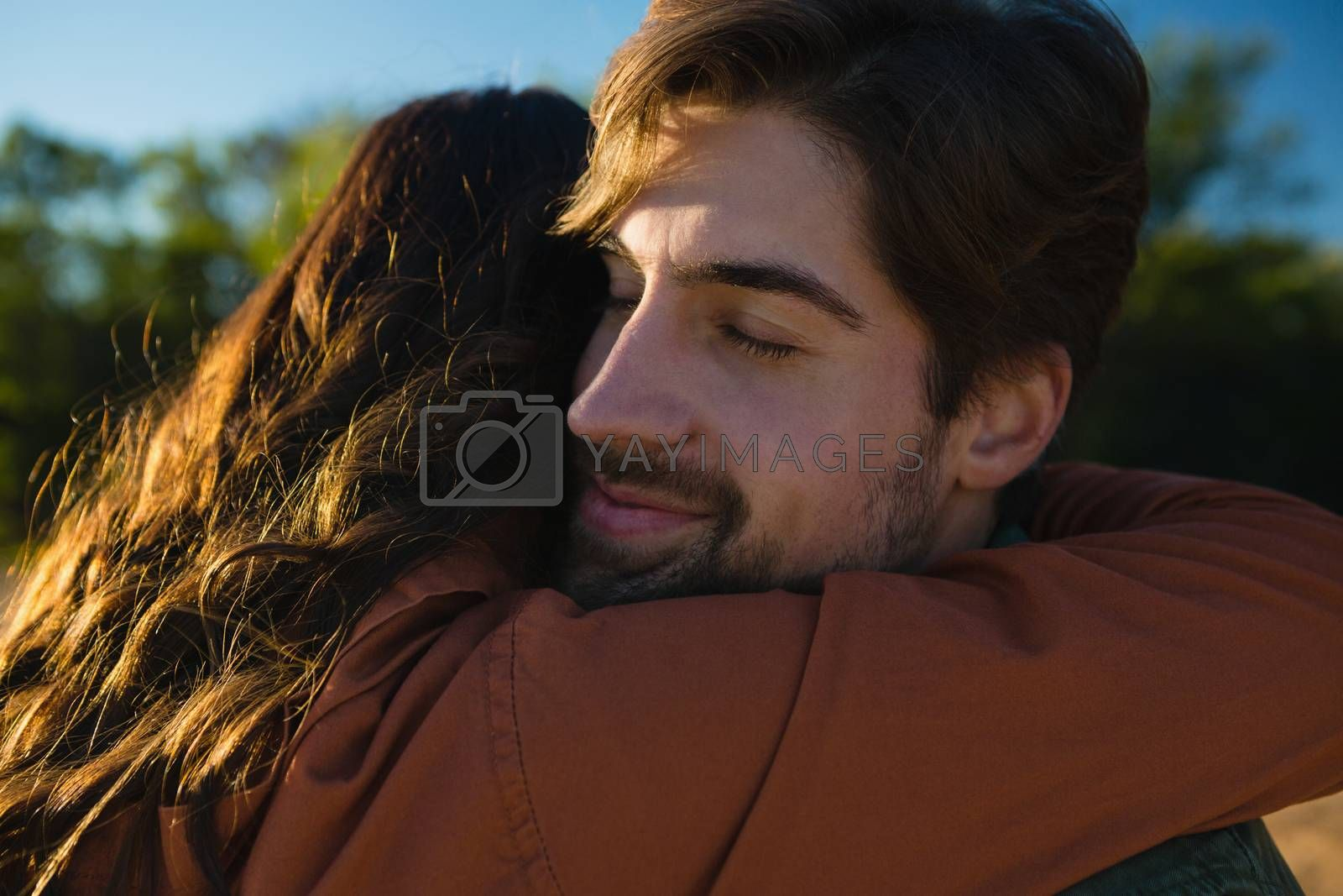 Young couple embracing by Wavebreakmedia