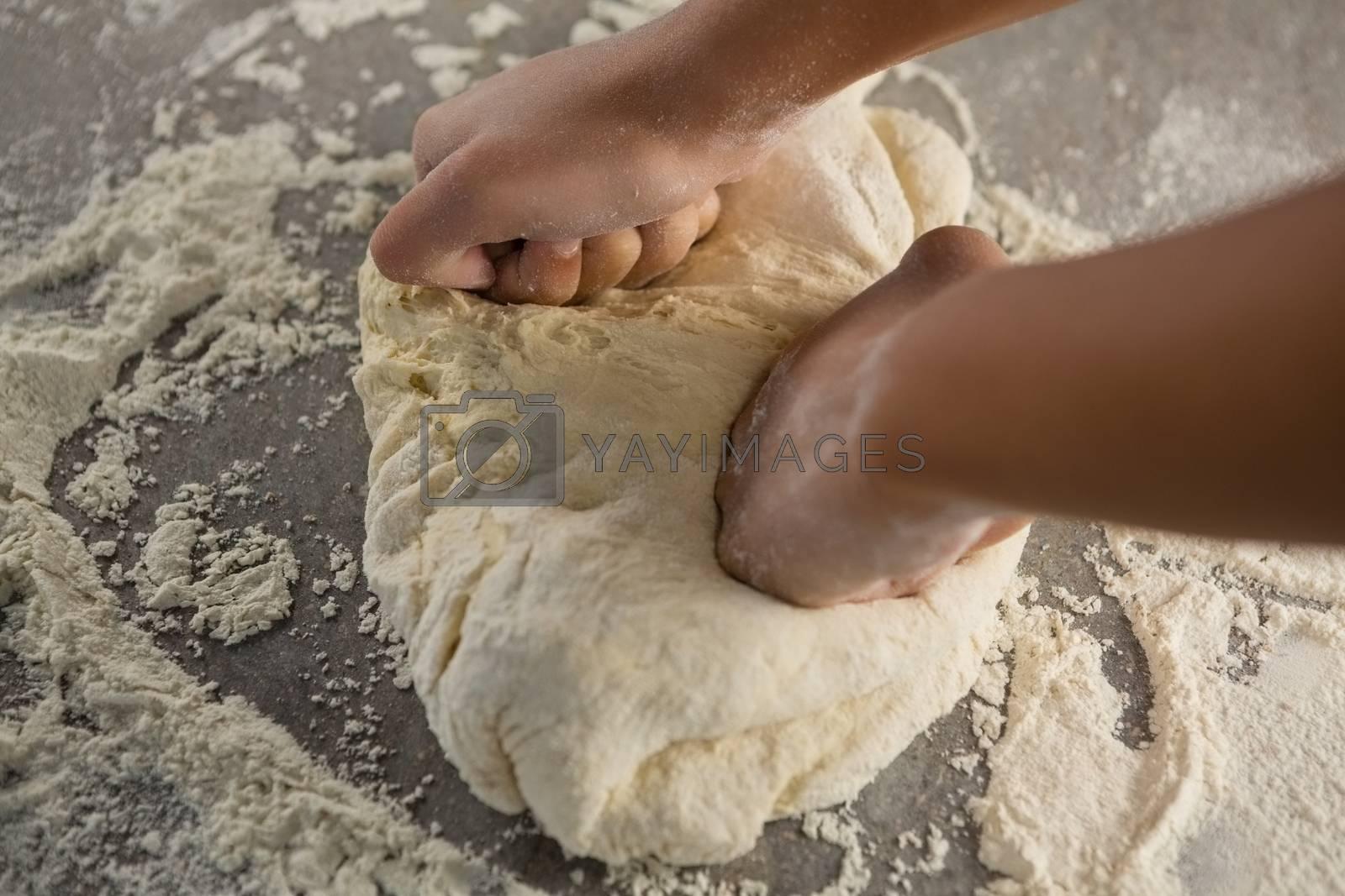 Woman kneading a dough by Wavebreakmedia