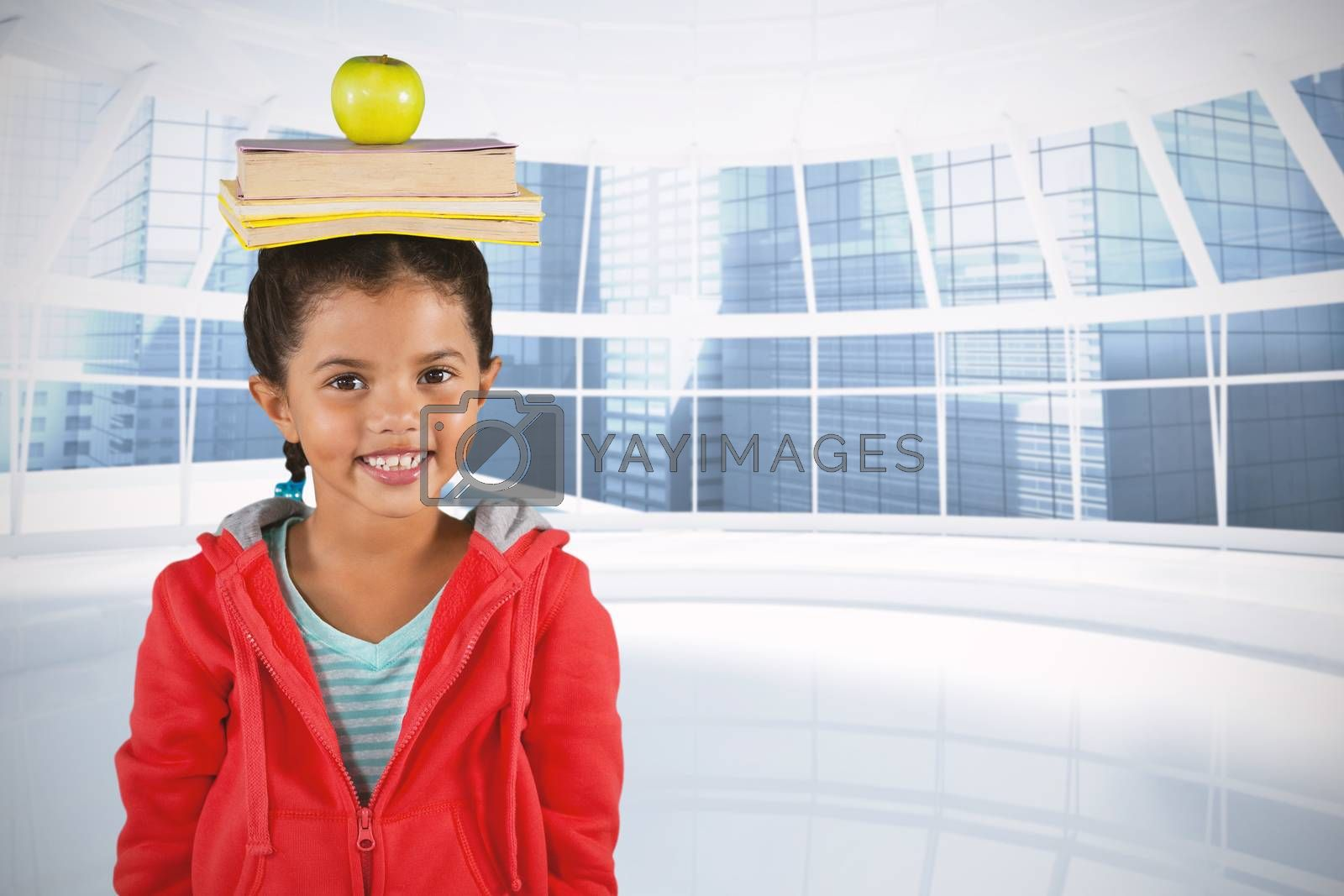 Composite image of smiling girl balancing books and apple on head by Wavebreakmedia