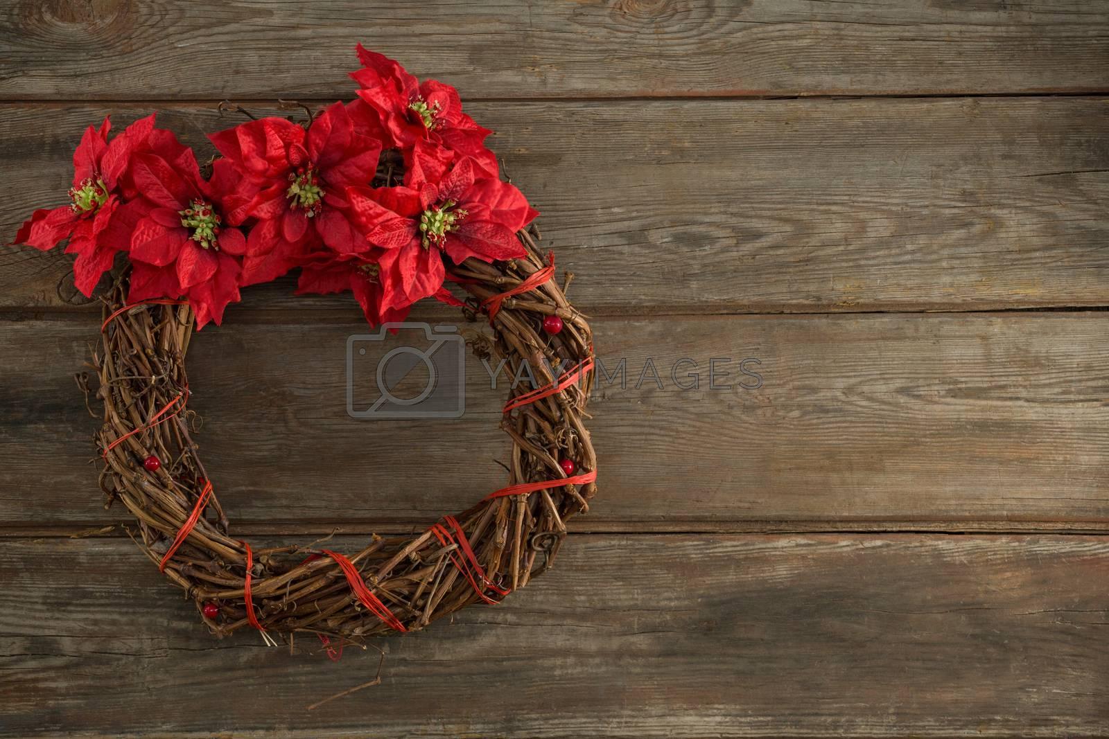 Christmas wreath on wooden plank by Wavebreakmedia
