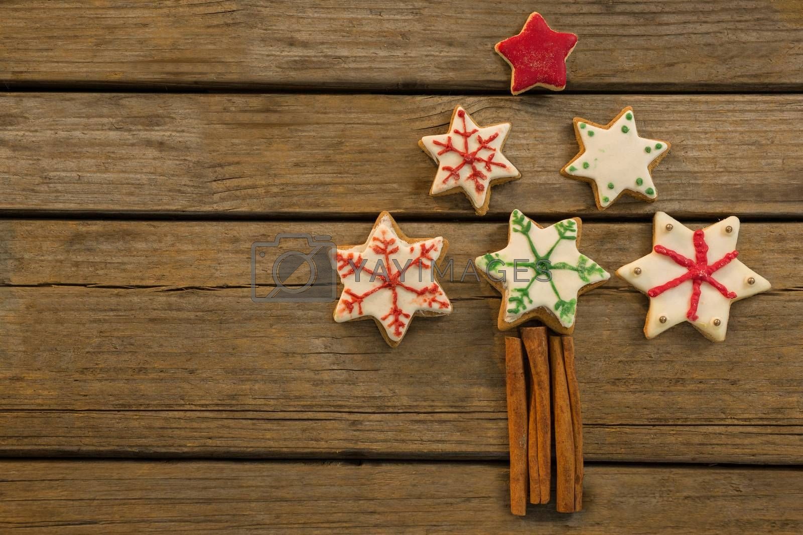 Overhead view of Christmas tree made with star shape cookies and cinnamon sticks by Wavebreakmedia