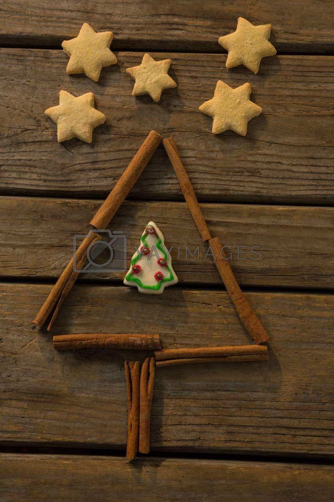 Overhead view of star shape cookies by Christmas tree made with cinnamon stick by Wavebreakmedia