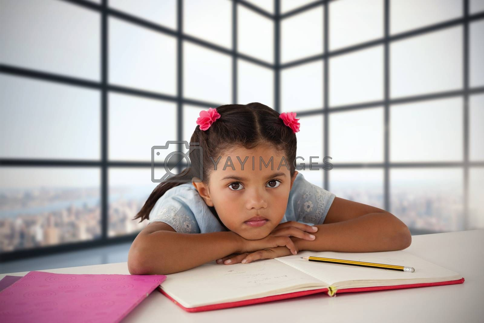 Composite image of girl leaning on open book at desk by Wavebreakmedia