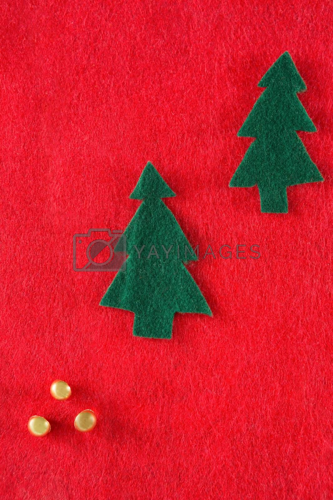 Christmas decorations on red background by Wavebreakmedia