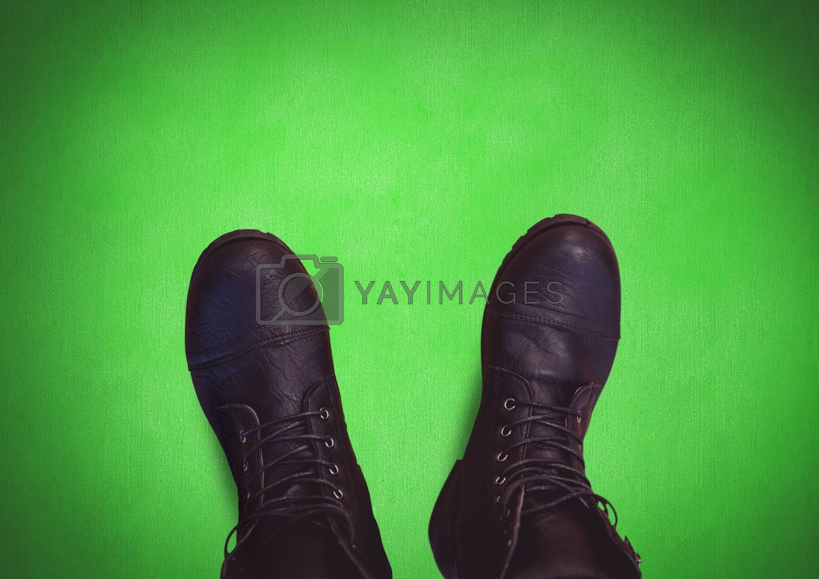 Black shoes on feet with green background by Wavebreakmedia