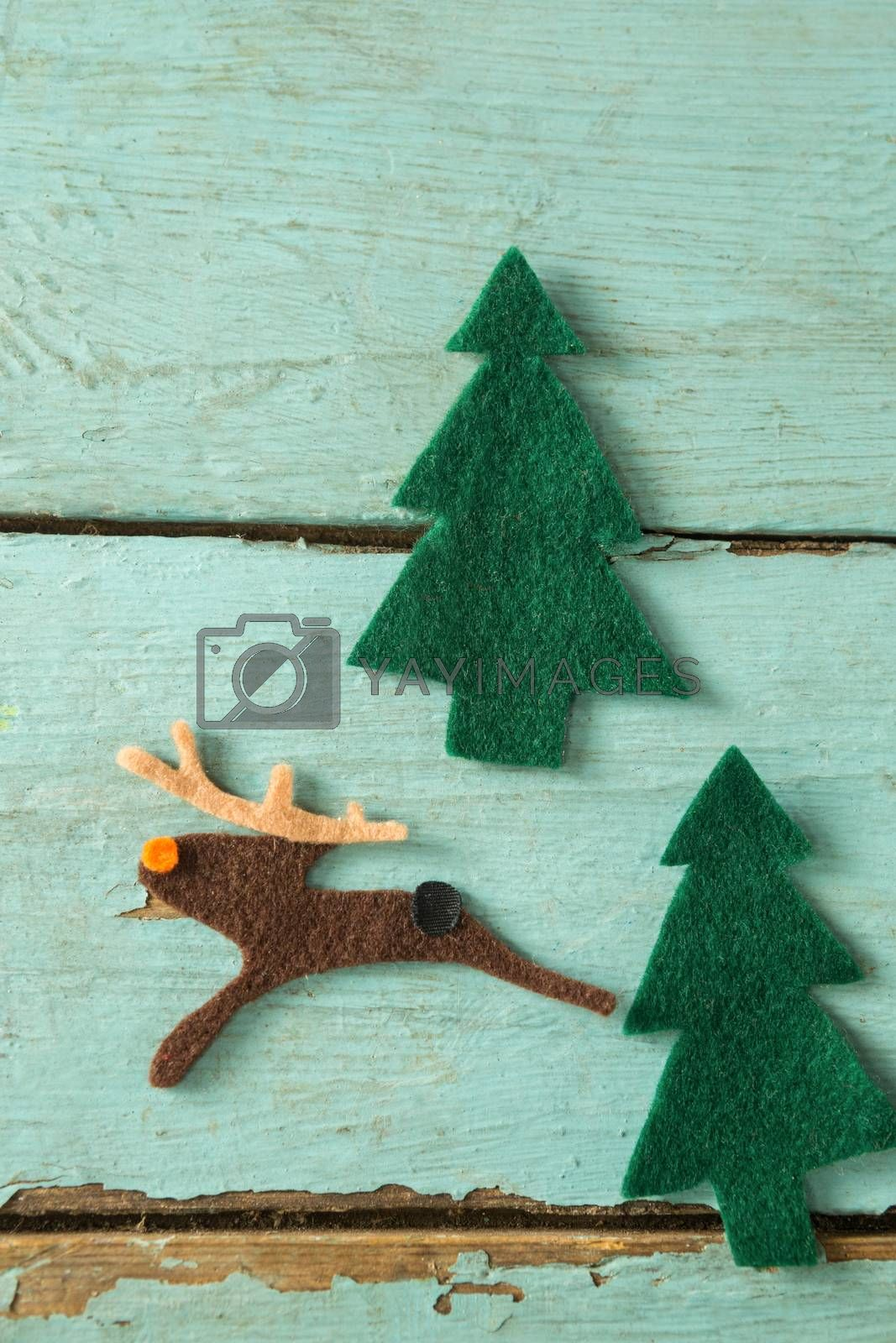 Christmas decorations on wooden plank by Wavebreakmedia