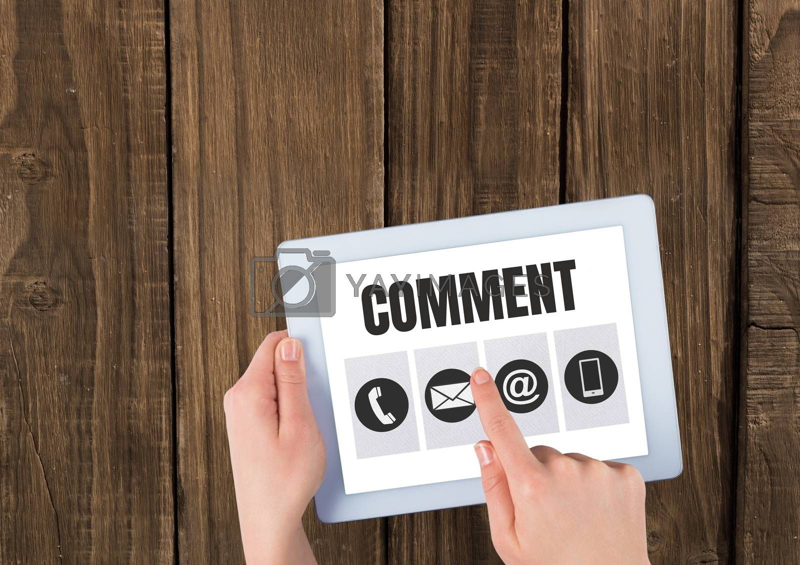 Comment text and graphic on tablet screen with hands by Wavebreakmedia