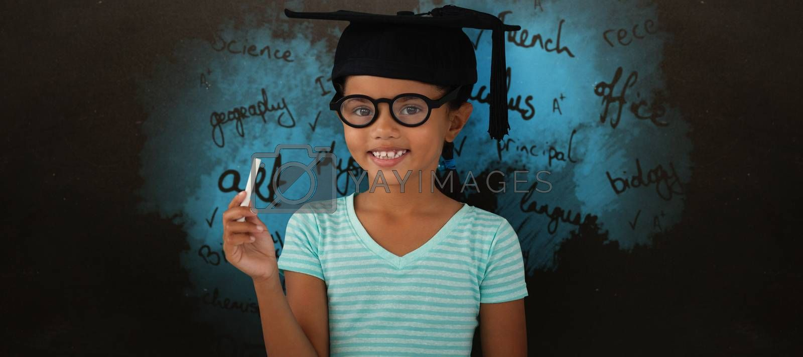 Composite image of portrait of smiling girl wearing mortarboard and holding chalk by Wavebreakmedia