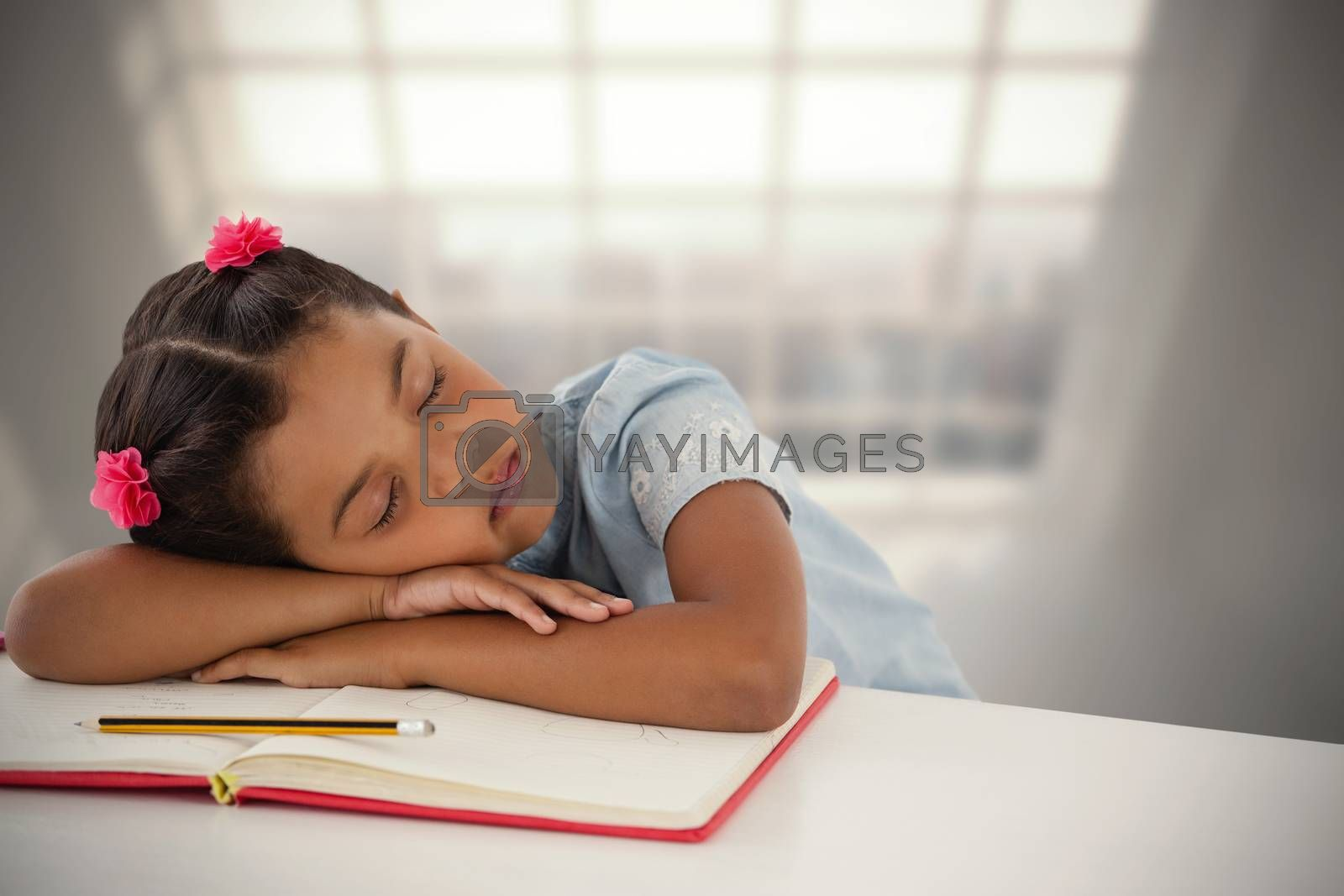 Composite image of girl napping on book at desk by Wavebreakmedia