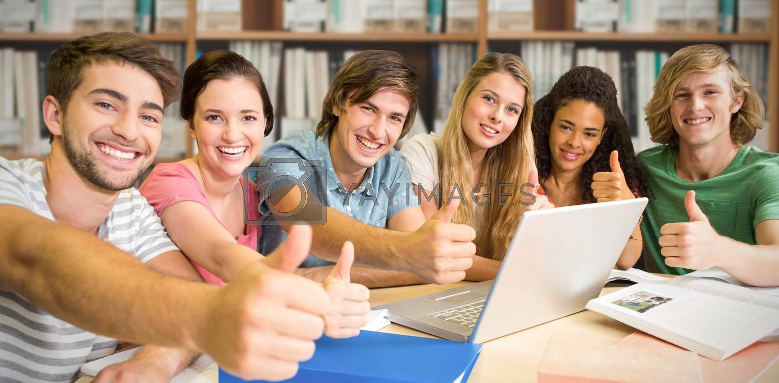 Composite image of college students gesturing thumbs up in library by Wavebreakmedia