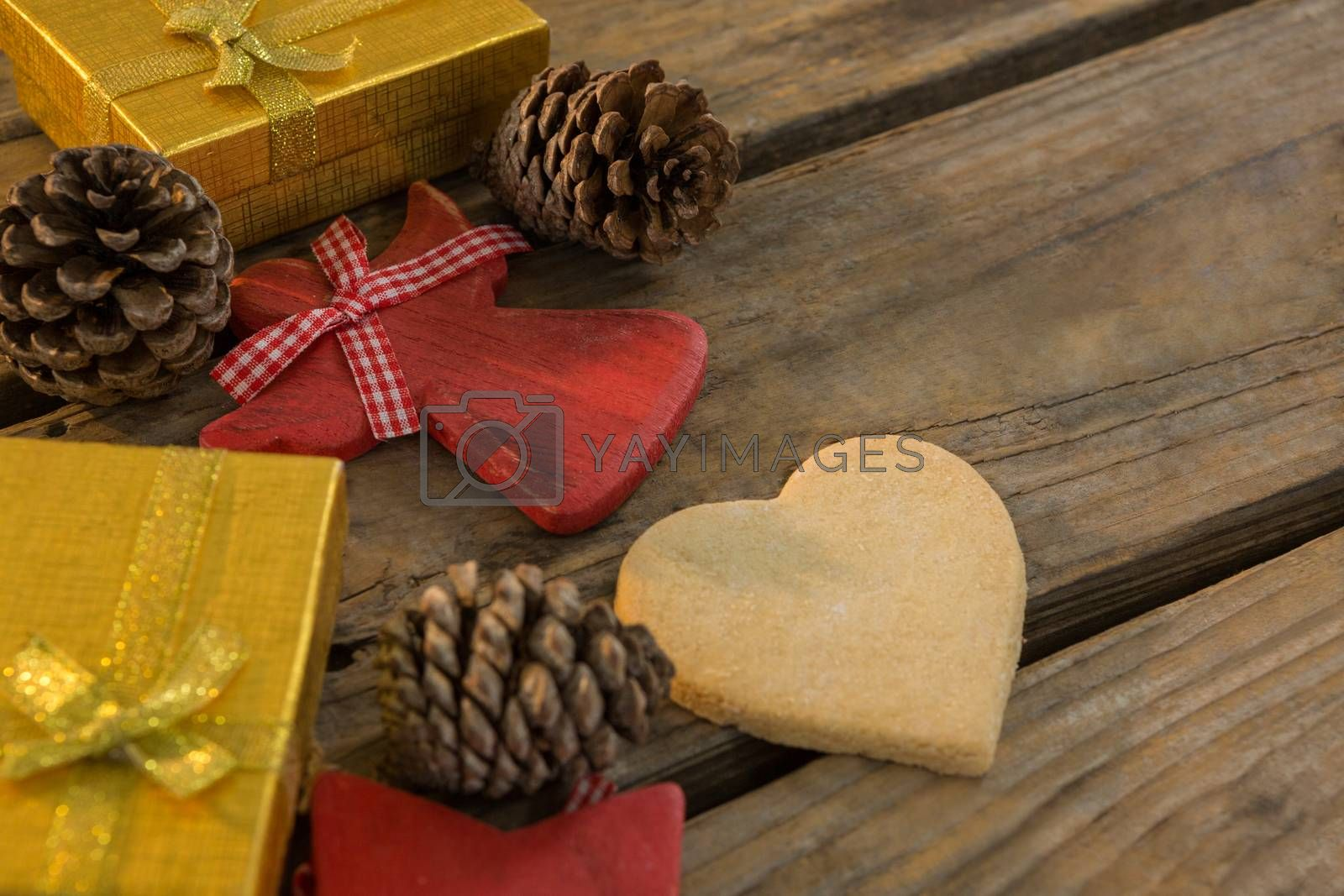High angle view of pine cones with gift boxes by Wavebreakmedia