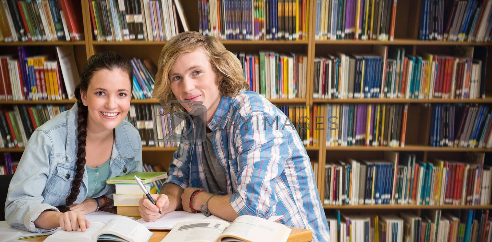 Composite image of college students doing homework in library by Wavebreakmedia