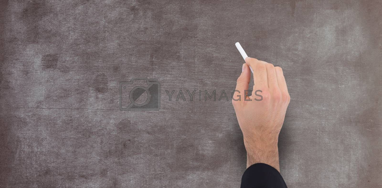 Composite image of hand of a businessman writing with a white chalk by Wavebreakmedia